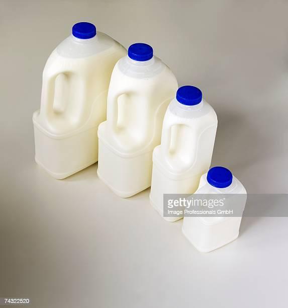 Milk in various plastic bottles