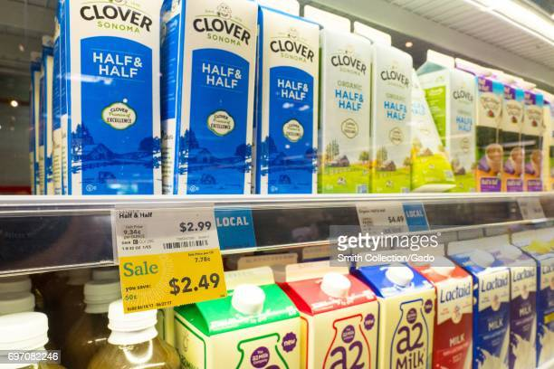 Milk is on display with a label reading 'Sale' at Whole Foods Market grocery store in Dublin California June 16 2017 On June 16 Amazoncom announced...