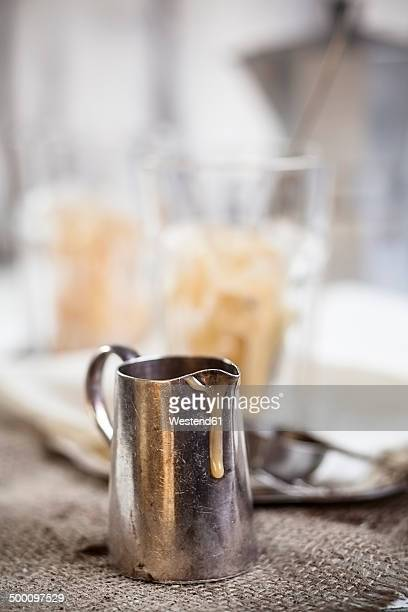 Milk jug with drips of condensed milk