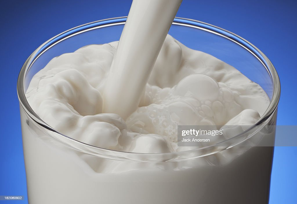 Milk pour in a glass : Stock Photo