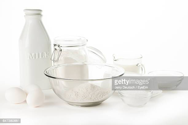 Milk With Eggs And Flour On White Background