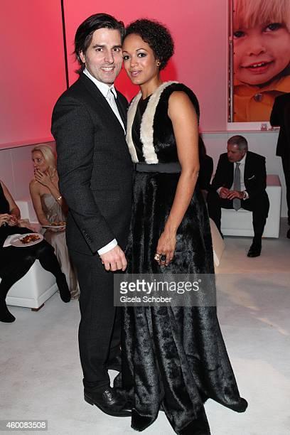 Milka Loff Fernandes and her huasband Robert Irschara attend the Ein Herz fuer Kinder Gala 2014 after show party at Tempelhof Airport on December 6...