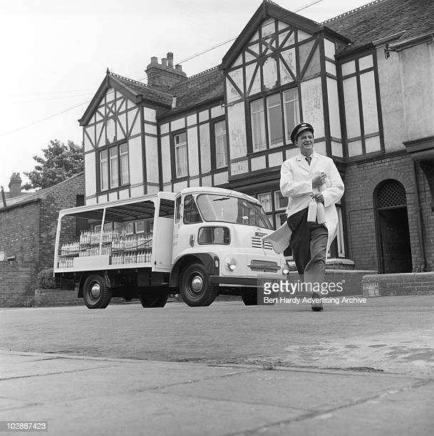 A milkman making his deliveries in an Austin milk float Hull 13th July 1961