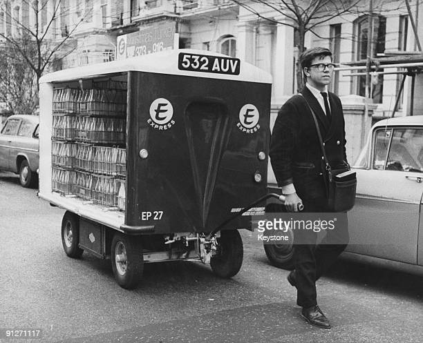 A milkman on his rounds with his handpulled float 1966