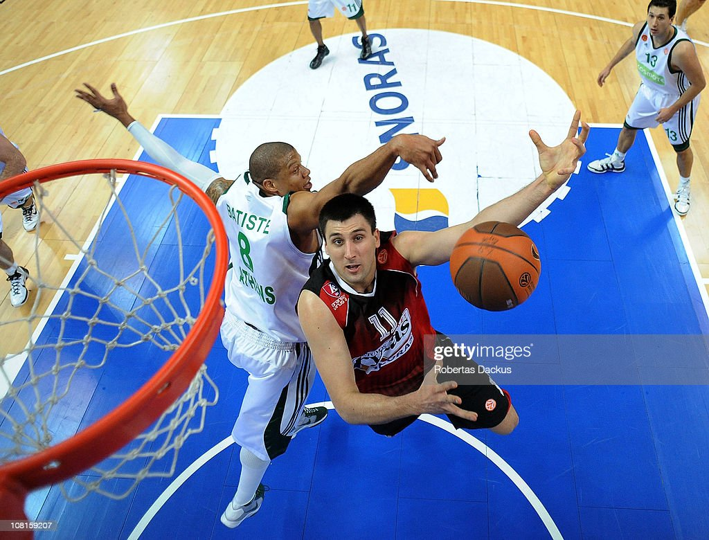 Milko Bjelica #11 of Lietuvos Rytas in action against Mike Batiste #8 of Panathinaikos Athens during the 20102011 Turkish Airlines Euroleague Top 16...