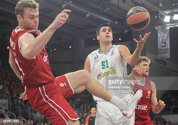 Milko Bjelica #51 of Darussafaka Dogus Istanbul competes with Nicolo Melli #4 of Brose Baskets Bamberg during the Turkish Airlines Euroleague Regular...