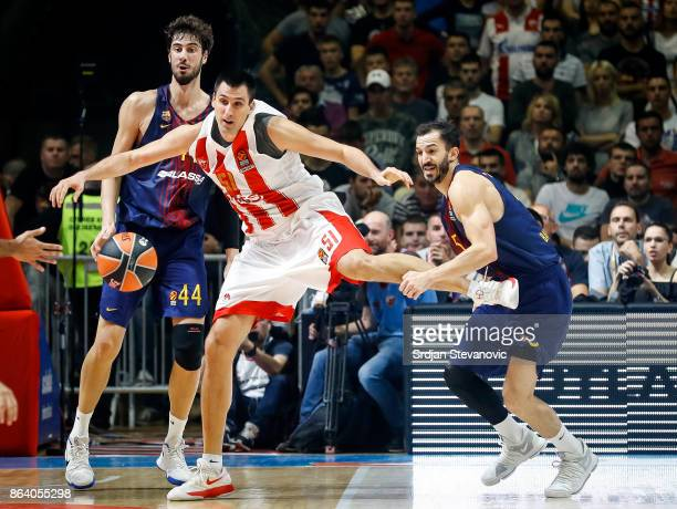Milko Bjelica of Crvena Zvezda is challenged by Ante Tomic and Pau Ribas of Barcelona during the 2017/2018 Turkish Airlines EuroLeague Regular Season...