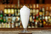 "A tender milkshake with cream is on the bar in a cafe or restaurant, place for text""n"