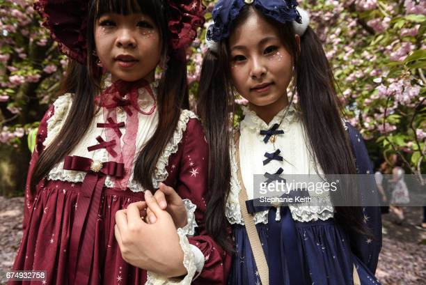 Milky Lin 19 and her friend Camellia Zhong wear Lolita style fashion at the Brooklyn Botanic Garden's Cherry Blossom Festival on April 29 2017 in the...