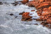 Rocks in soft white milky sea water.
