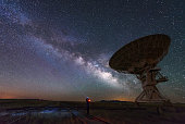 Milky way and big antenna dish at Very Large Array, New Mexico, USA. Powerful telescope for astronomy searching