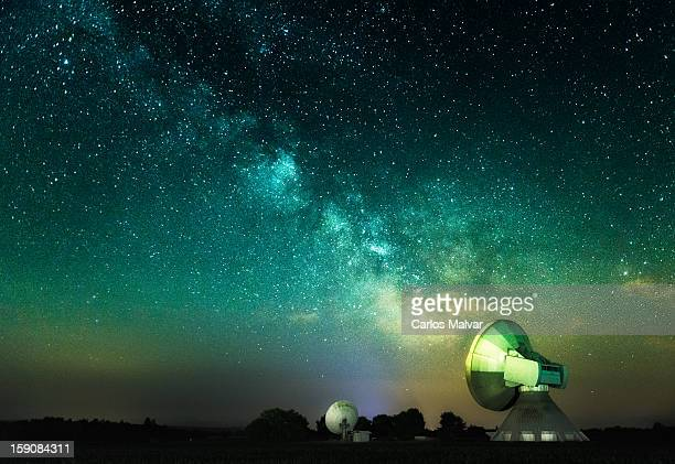 Milky way and parabolic antenna