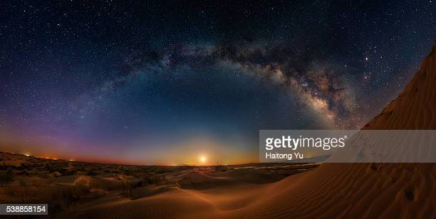Milky way bridge over huge sand dunes
