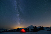 Milky Way and Mount Baker, red tent in foreground