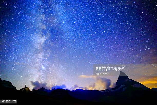 Milky Way galaxy above Matterhorn, Swiss Alps landscape at night