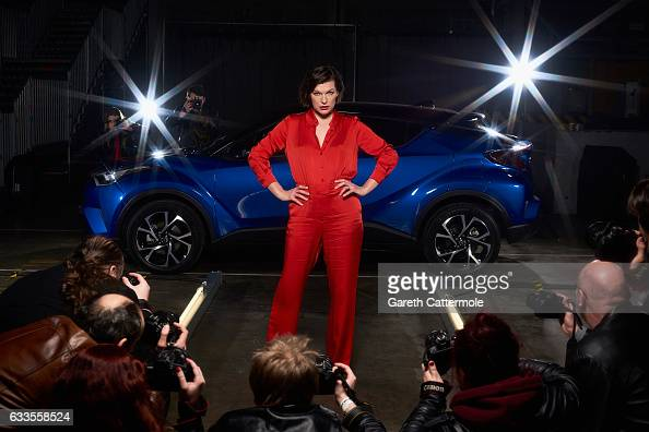 Milla Jovovich actress and model is captured stepping out of the new Toyota CHR onto a catwalk at the worlds first drive through immersive theatre...