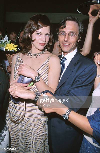 Milla Jovovich and Alain Viot CEO of Cartier during Cartier Launches New Men's Watch '21 de Cartier' at 21 Club in Beverly Hills California United...