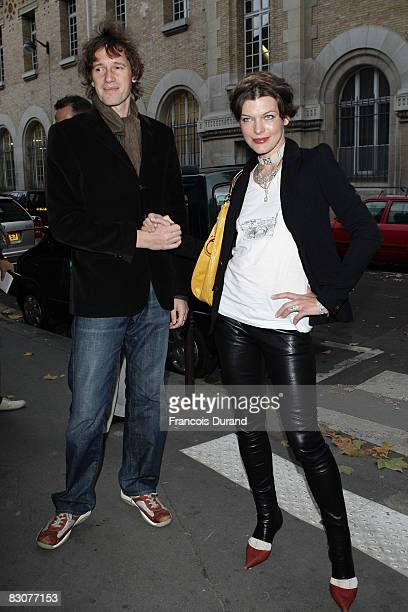 Milla Jovovich and director Paul WS Anderson arrive at the Givenchy Show during Paris Fashion Week at Carreau du Temple Turenne on October 1 2008 in...