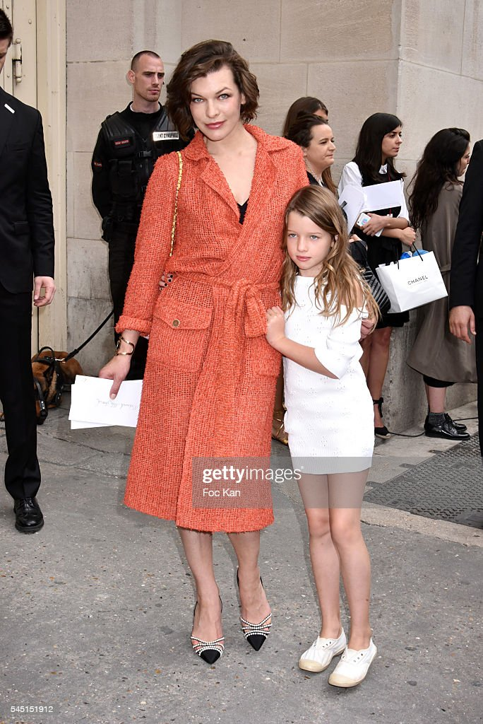 Milla Jovovich and her daughter Ever Gabo Anderson attend the Chanel show during Paris Fashion Week Haute Couture Fall/Winter 20162017 on July 5 2016...