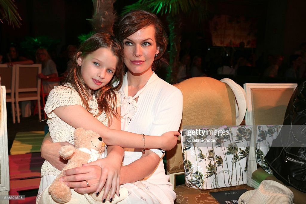 Milla Jovovich and her daughter Ever Gabo Anderson during the Marc Cain fashion show spring/summer 2017 at CITY CUBE Panorama Bar on June 28, 2016 in Berlin, Germany.