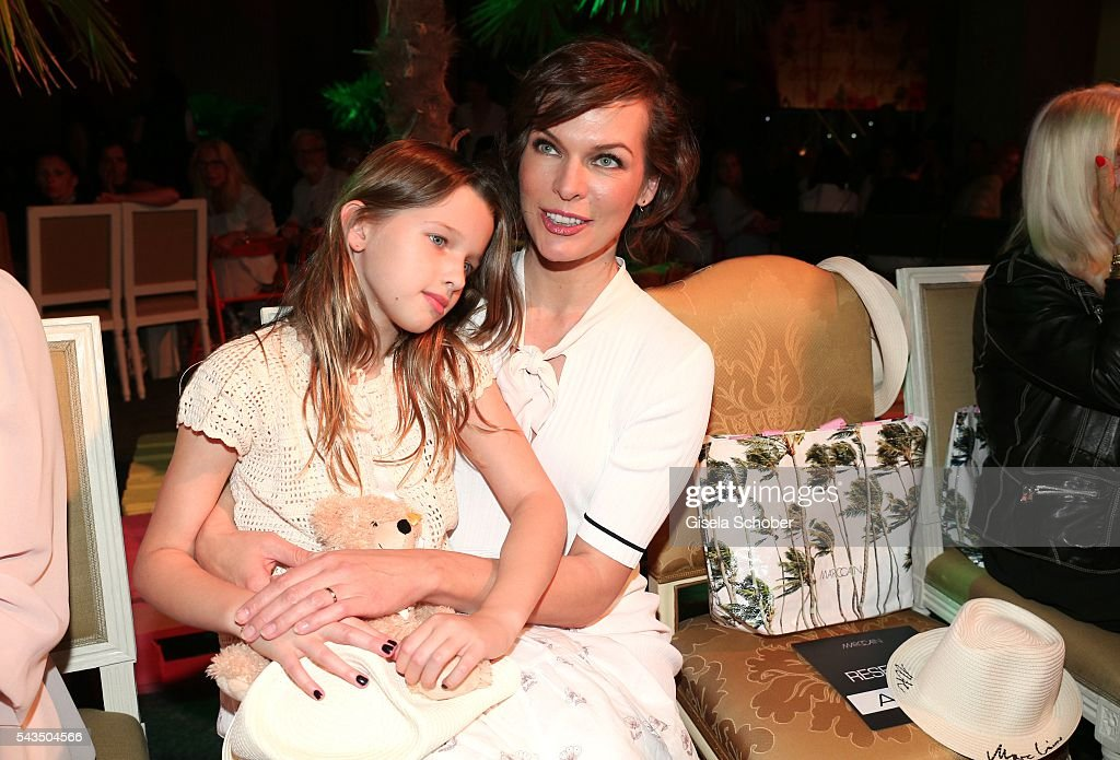 Milla Jovovich and her daughter Ever Gabo Anderson during the Marc Cain fashion show spring/summer 2017 at CITY CUBE Panorama Bar on June 28 2016 in...