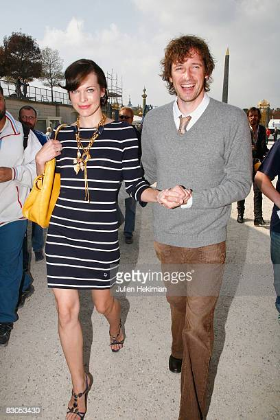 Milla Jovovich and her husband arrive at the Christian Dior fashion show during Paris Fashion Week Spring/Summer 2009 on September 29 2008 in Paris...