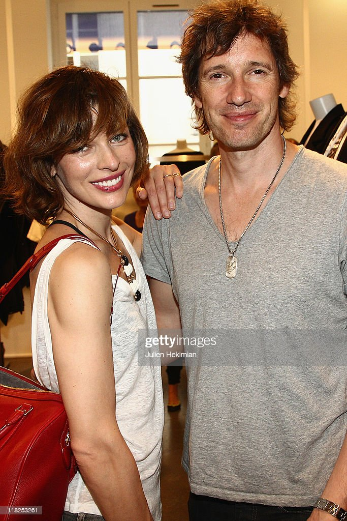 <a gi-track='captionPersonalityLinkClicked' href=/galleries/search?phrase=Milla+Jovovich&family=editorial&specificpeople=202207 ng-click='$event.stopPropagation()'>Milla Jovovich</a> and her husband Paul WS Anderson attend the cocktail for the launch of Claudia Schiffer cashmere collection at Colette on July 5, 2011 in Paris, France.