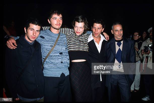 Milla Jovovich and her husband pose with other guests September 17 1999 during the Vivienne Westwood Fashion Show in New York City British fashion...