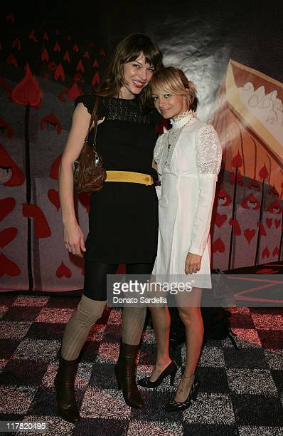 Milla Jovovich and Nicole Richie during Disney's Alice in Wonderland Mad Tea Party at Private Residence in Los Angeles California United States