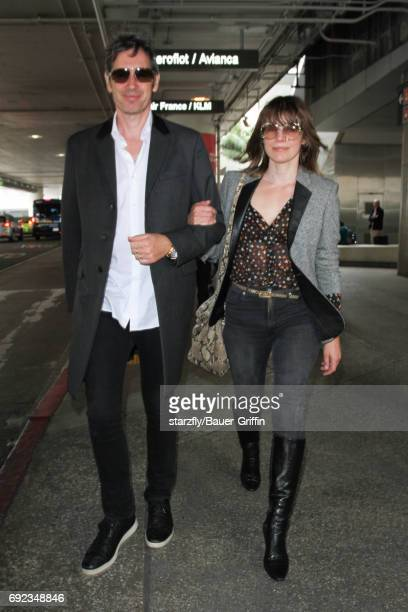 Milla Jovovich and Paul Anderson are seen at LAX on June 04 2017 in Los Angeles California