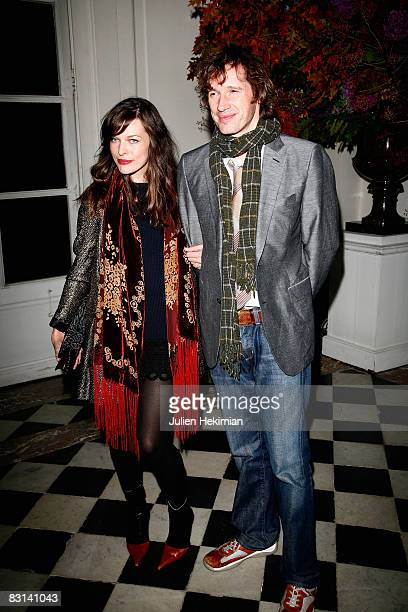 Milla Jovovich and Paul Anderson attend the Ralph Lauren dinner at the Pozzo Di Borgo Hotel on October 3 2008 in Paris France