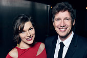 Milla Jovovich and Paul WS Anderson pose for a portrait at the amfAR LA Inspiration Gala on October 29 2014 in Los Angeles California