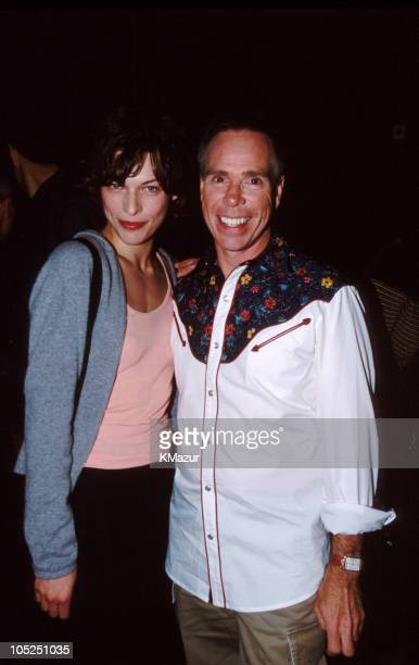 Milla Jovovich and Tommy Hilfiger during Tommy Hilfiger Fall 1999 Fashion Show Front Row and Backstage at Roseland in New York City New York United...