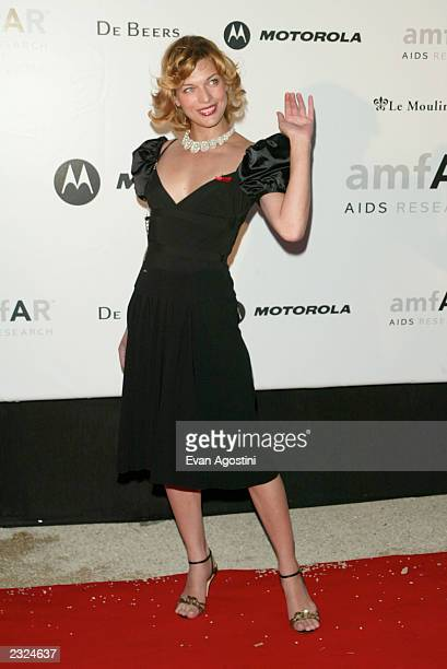 Milla Jovovich arriving at amfAr's Cinema against AIDS 2002 benefit gala at Le Moulin de Mougins during the 55th Cannes Film Festival in Cannes...