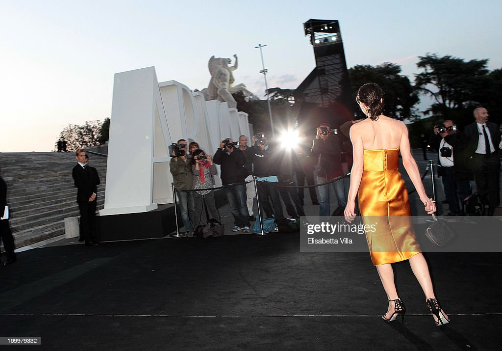<a gi-track='captionPersonalityLinkClicked' href=/galleries/search?phrase=Milla+Jovovich&family=editorial&specificpeople=202207 ng-click='$event.stopPropagation()'>Milla Jovovich</a> attends 'One Night Only' Roma hosted by Giorgio Armani at Palazzo Civilta Italiana on June 5, 2013 in Rome, Italy.