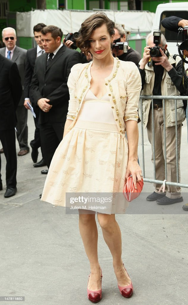 Milla Jovovich attends the Chanel Haute-Couture Show as part of Paris Fashion Week Fall / Winter 2012/13 at Grand Palais on July 3, 2012 in Paris, France.