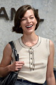 Milla Jovovich attends the Chanel show as part of Paris Fashion Week HauteCouture Fall/Winter 20132014 at Grand Palais on July 2 2013 in Paris France