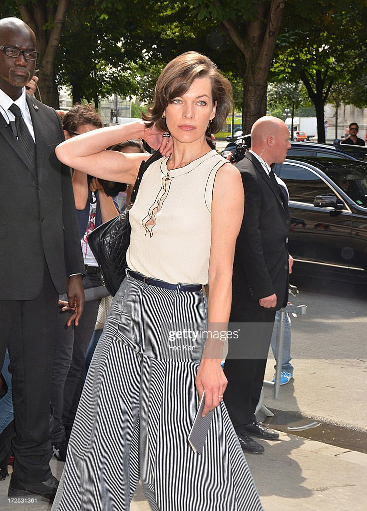 Milla Jovovich attends the Chanel show as part of Paris Fashion Week Haute-Couture Fall/Winter 2013-2014 at the Grand Palais on July 2, 2013 in Paris, France.