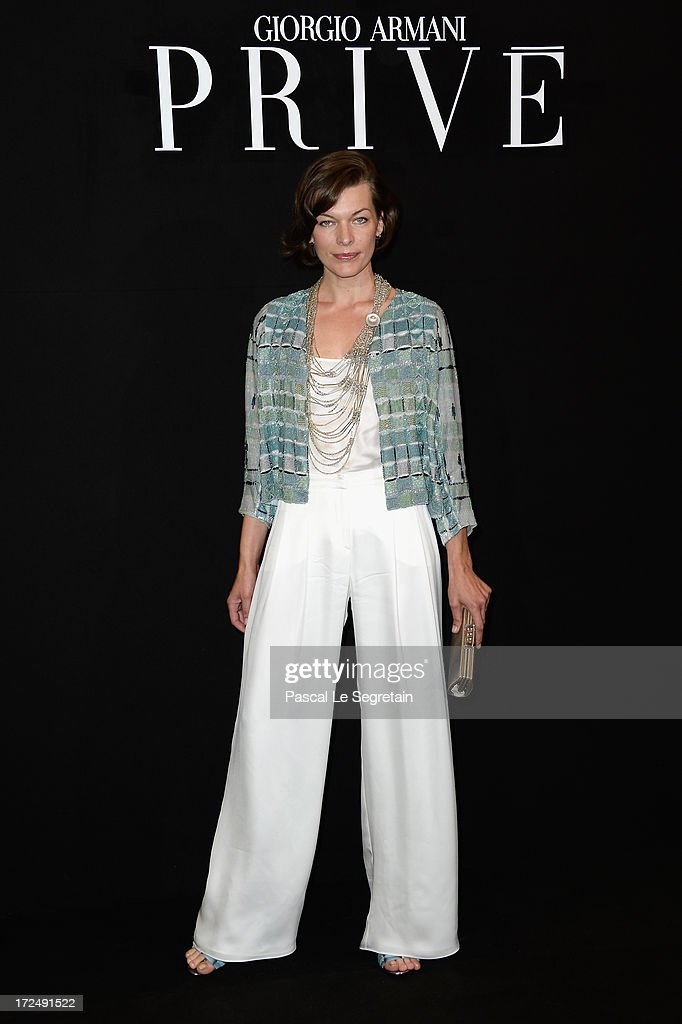 Milla Jovovich attends the Giorgio Armani Prive show as part of Paris Fashion Week Haute-Couture Fall/Winter 2013-2014 at Theatre National de Chaillot on July 2, 2013 in Paris, France.