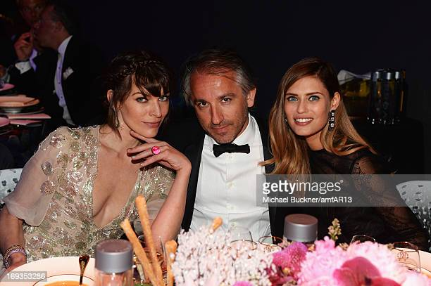 Milla Jovovich Cyril Chapuy and Bianca Balti attend amfAR's 20th Annual Cinema Against AIDS during The 66th Annual Cannes Film Festival at Hotel du...