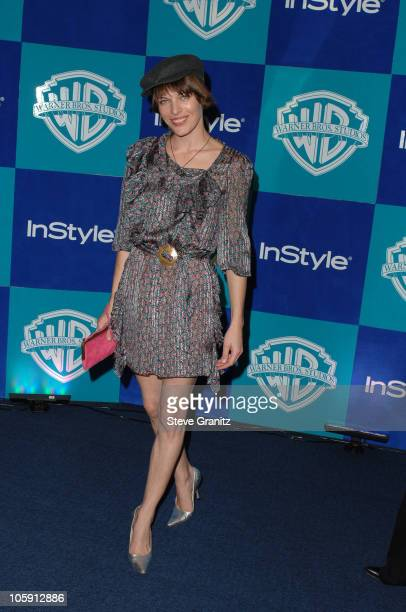 Milla Jovovich during InStyle Warner Bros 2006 Golden Globes After Party Arrivals at Beverly Hilton in Beverly Hills California United States