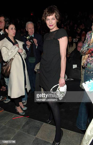 Milla Jovovich during Olympus Fashion Week Fall 2006 Zac Posen Front Row and Backstage at Bryant Park in New York City New York United States