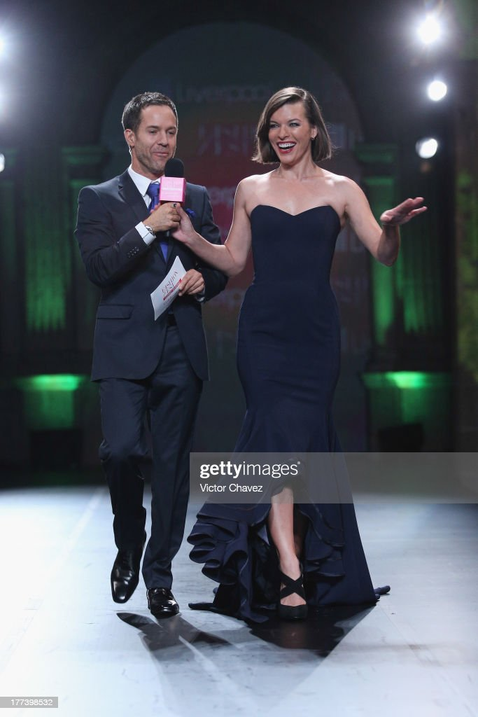 <a gi-track='captionPersonalityLinkClicked' href=/galleries/search?phrase=Milla+Jovovich&family=editorial&specificpeople=202207 ng-click='$event.stopPropagation()'>Milla Jovovich</a> (R) is interviewed by the host on the catwalk during the Liverpool Fashion Fest Autumn/Winter 2013 at Club De Banqueros on August 22, 2013 in Mexico City, Mexico.