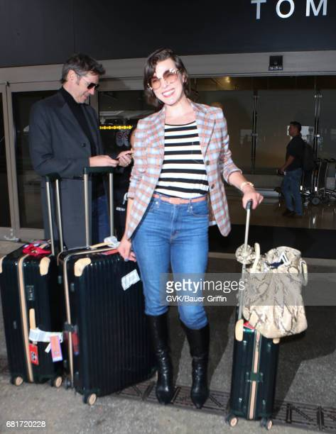 Milla Jovovich is seen at LAX on May 10 2017 in Los Angeles California