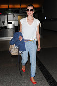 Milla Jovovich seen at LAX on August 02 2014 in Los Angeles California