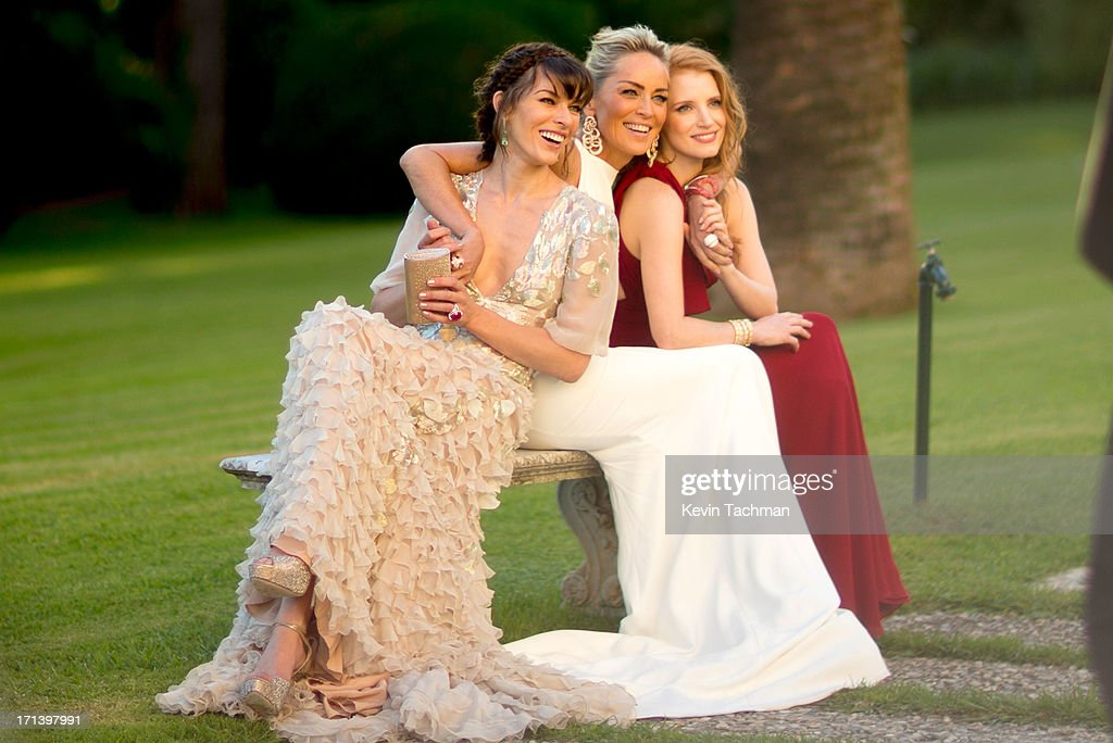 (L-R) Milla Jovovich, Sharon Stone and Jessica Chastain attend at the cocktail party for amfAR's 20th Annual Cinema Against AIDS at Hotel du Cap-Eden-Roc on May 23,2013 in Cap d'Antibes, France.