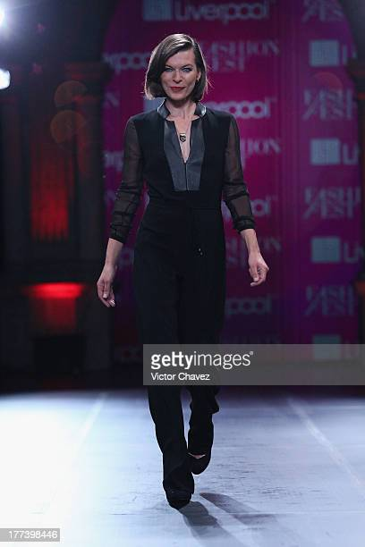 Milla Jovovich walks the runway during Liverpool Fashion Fest Autumn/Winter 2013 at Club De Banqueros on August 22 2013 in Mexico City Mexico