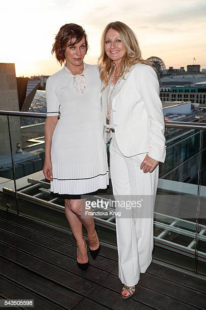 Milla Jovovichr and Frauke Ludowig attend the Marc Cain show spring/summer 2017 at CITY CUBE Panorama Bar on June 28 2016 in Berlin Germany