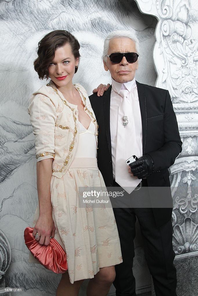 Milla Jovovitch and Karl Lagerfeld attend the Chanel Haute-Couture Show as part of Paris Fashion Week Fall / Winter 2013 at Grand Palais on July 3, 2012 in Paris, France.