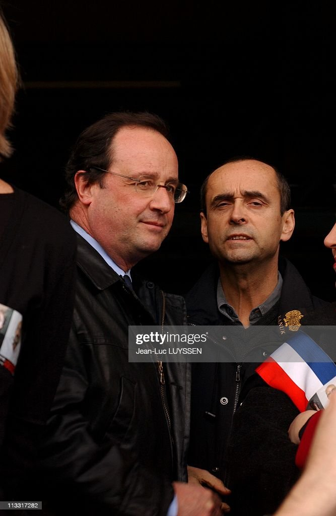 'Mille Fanfares Pour Florence Et Hussein', National Movement Of Brass Band For The Release Of French Journalist <a gi-track='captionPersonalityLinkClicked' href=/galleries/search?phrase=Florence+Aubenas&family=editorial&specificpeople=3974602 ng-click='$event.stopPropagation()'>Florence Aubenas</a> And Her Guide Hussein Hanoun Kidnapped In Iraq On March 12Th, 2005 In Paris, France - In Paris, Meeting Taking Part In The National Movement 'Mille Fanfares Pour Les Otages' Played At The Villette, Facing Portraits Of The Two Hostages - French First Secretary Of Socialist Party Francois Hollande And <a gi-track='captionPersonalityLinkClicked' href=/galleries/search?phrase=Robert+Menard&family=editorial&specificpeople=554783 ng-click='$event.stopPropagation()'>Robert Menard</a>, President Of 'Reporters Sans Frontieres', Journalist Association.